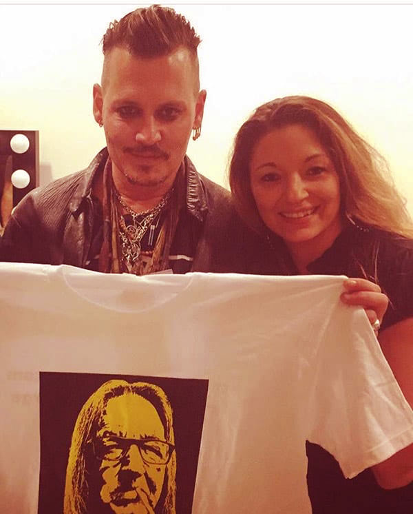 """Image of Caption: Kristina Sunshine and Johnny Depp, a clothing line branded """"Boston George Apparel and Merchandise"""""""