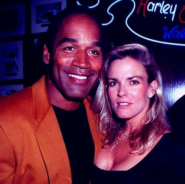 Image of Caption: Arnelle Simpson father O.J. Simpson with his second wife Nicole Brown