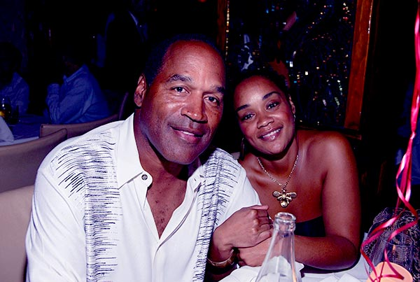 Image of Caption: Arnelle Simpson with her father O.J. Simpson