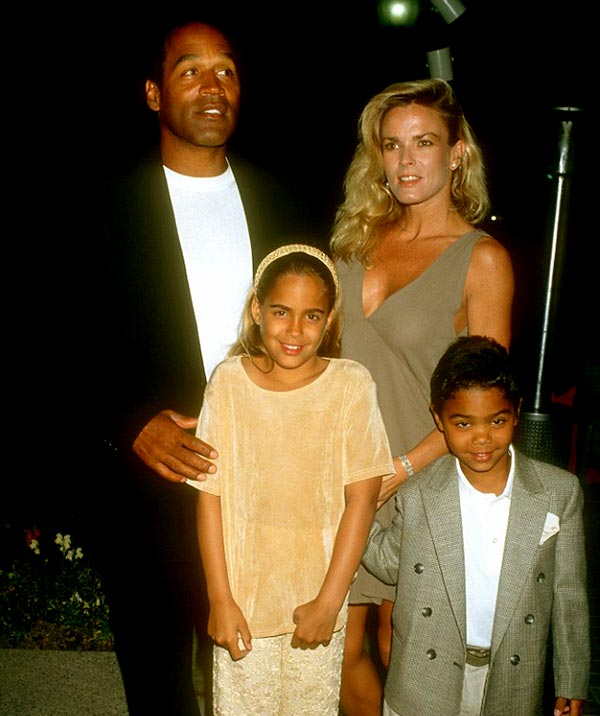 Image of Caption: O.J. Simpson with his wife Nicole and kids Sydney and Justin