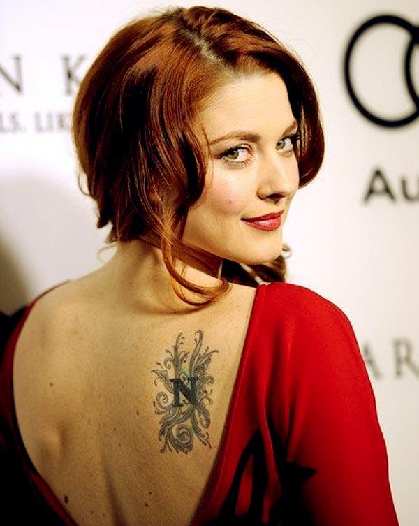 Image of Alexandra faint fairy tattoo across her back