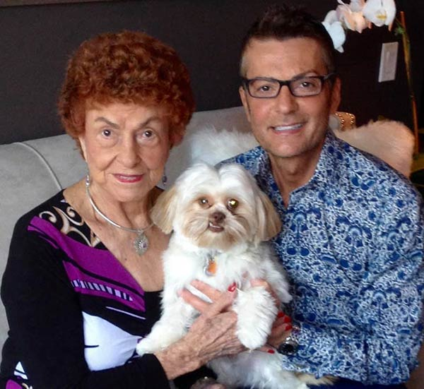 Image of Randy with his mother and dog
