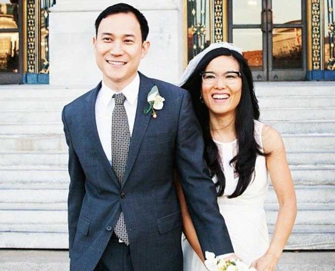 Weeding photo of Ali Wong and her husband, Justin Hakuta.