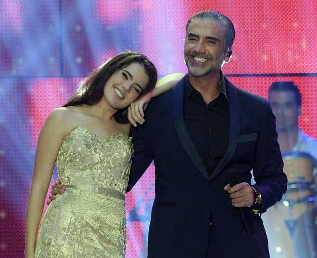 Photo of Alejandro Fernandez and his daughter Camila performing in the concert.