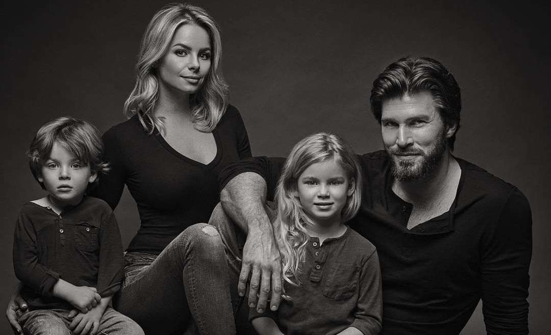 Christopher Russells with his wife and children